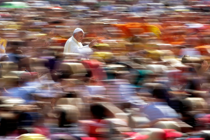 Pope Francis waves as he arrives to lead his weekly audience in Saint Peter's Square at the Vatican