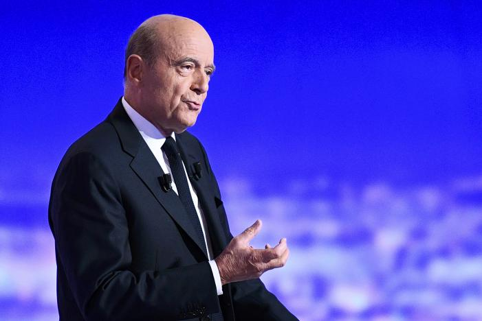 French politician Alain Juppe attends the first prime-time televised debate for the French conservative presidential primary in La Plaine Saint-Denis, near Paris