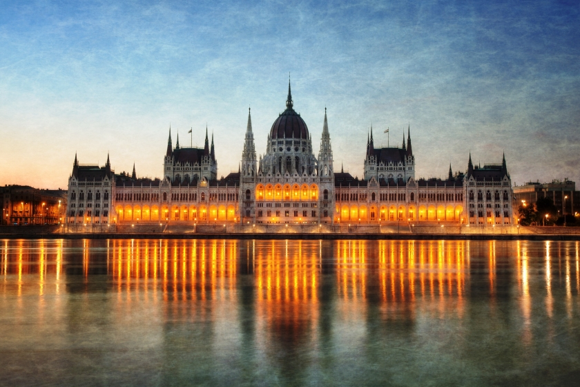 Sunrise behind the Hungarian Parliament building in Budapest.